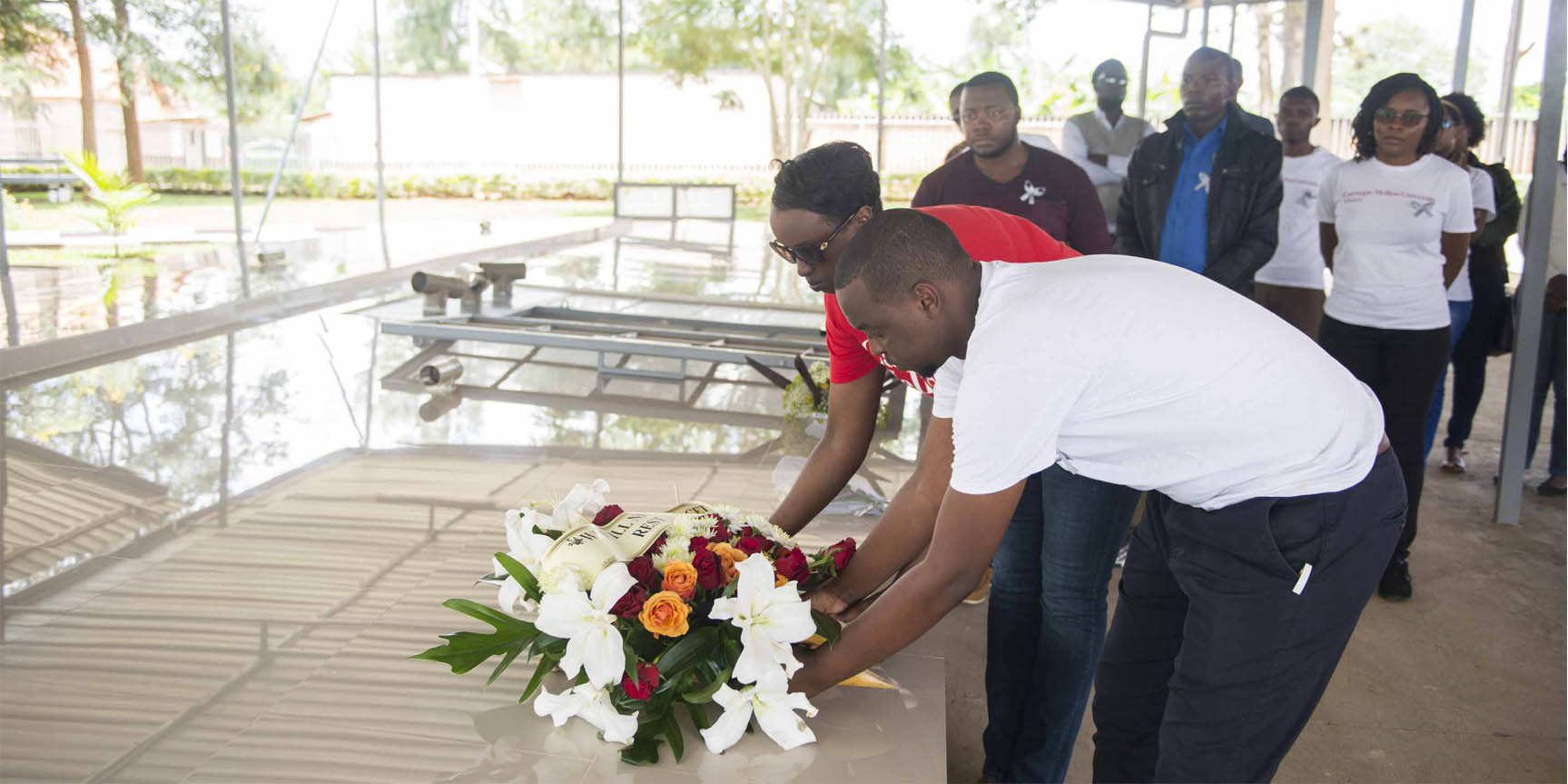 laying wreath of flowers at Nyamata genocide memorial site