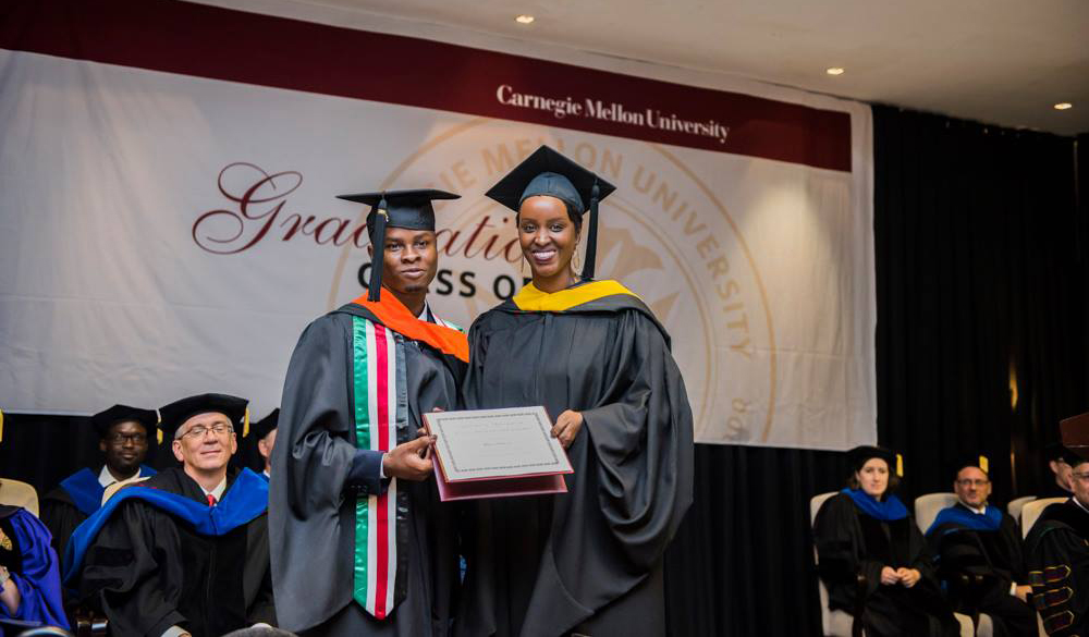 Brian Otieno (E'18) receiving the Jeremiah N. Mpagazehe Rising Researcher Award from the Director of Strategy and Operations, CMU-Africa, Crystal Rugege (HNZ'08).