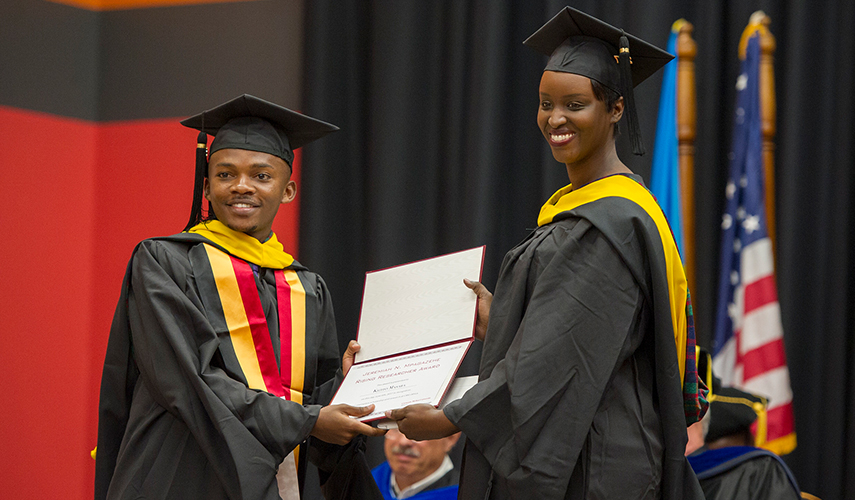Kizito Masaba (E'17) receiving the Jeremiah N. Mpagazehe Rising Researcher Award from the Director of Strategy and Operations, CMU-Africa, Crystal Rugege (HNZ'08).