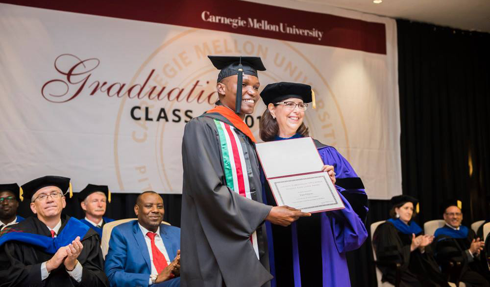 Fred Otieno (E'18) receiving the Lakshmi Subramanian CMU-Africa Student Excellence Award from the Interim Provost, CMU, Prof. Laurie Weingart.