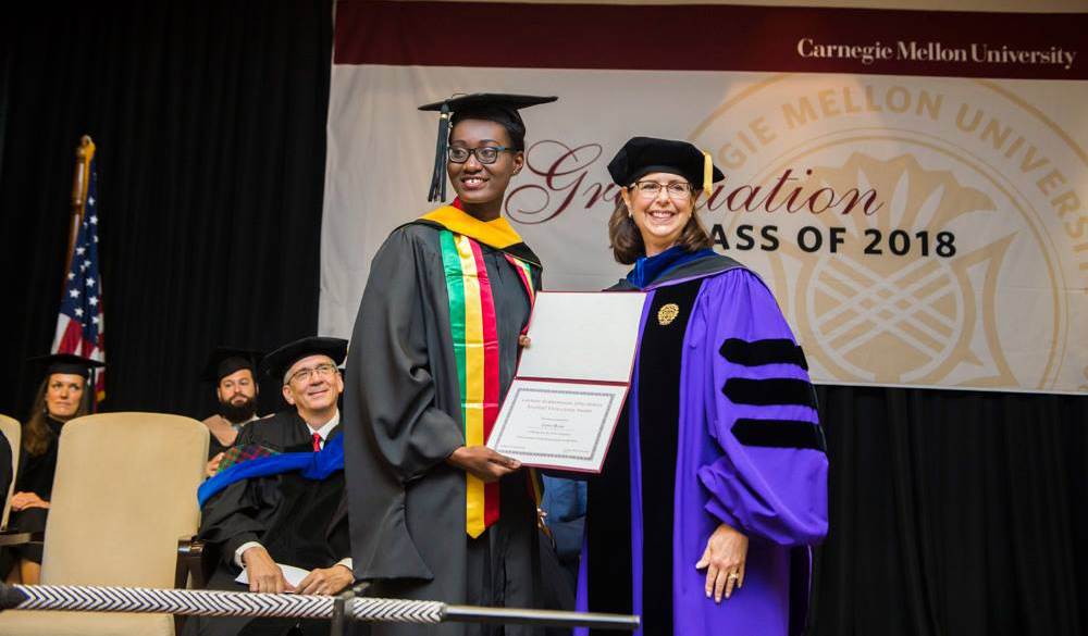 Gifty Buah (E'18) receiving the Lakshmi Subramanian CMU-Africa Student Excellence Award from the Interim Provost, CMU, Prof. Laurie Weingart.